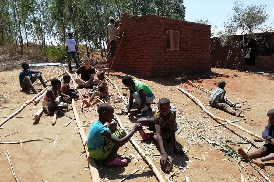 Children helping to prepare for the roof